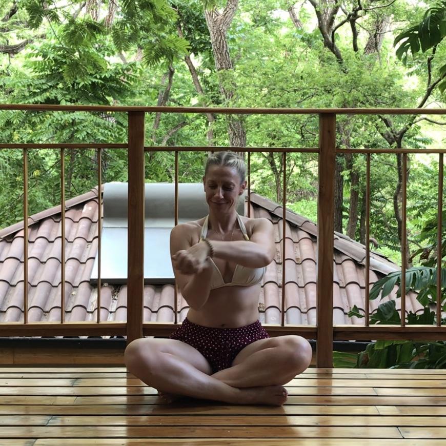 Julie Sinner doing a wrist stretch