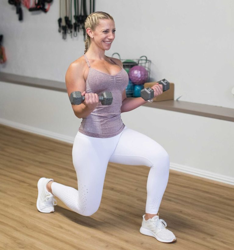 Julie doing a bicep curl and knee dip