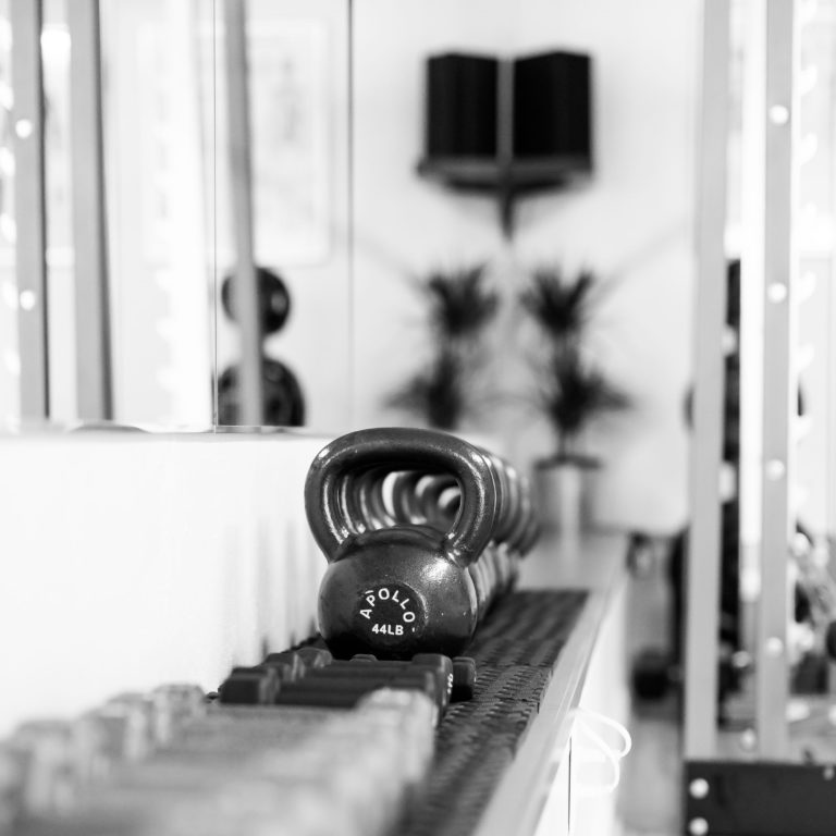 Black and white photo of kettlebells in the gym